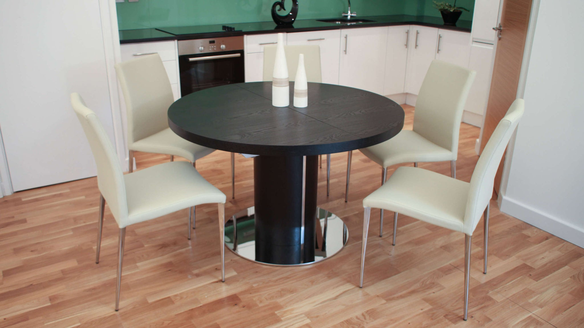Stylish Black Extending Dining Table and Cream Chairs