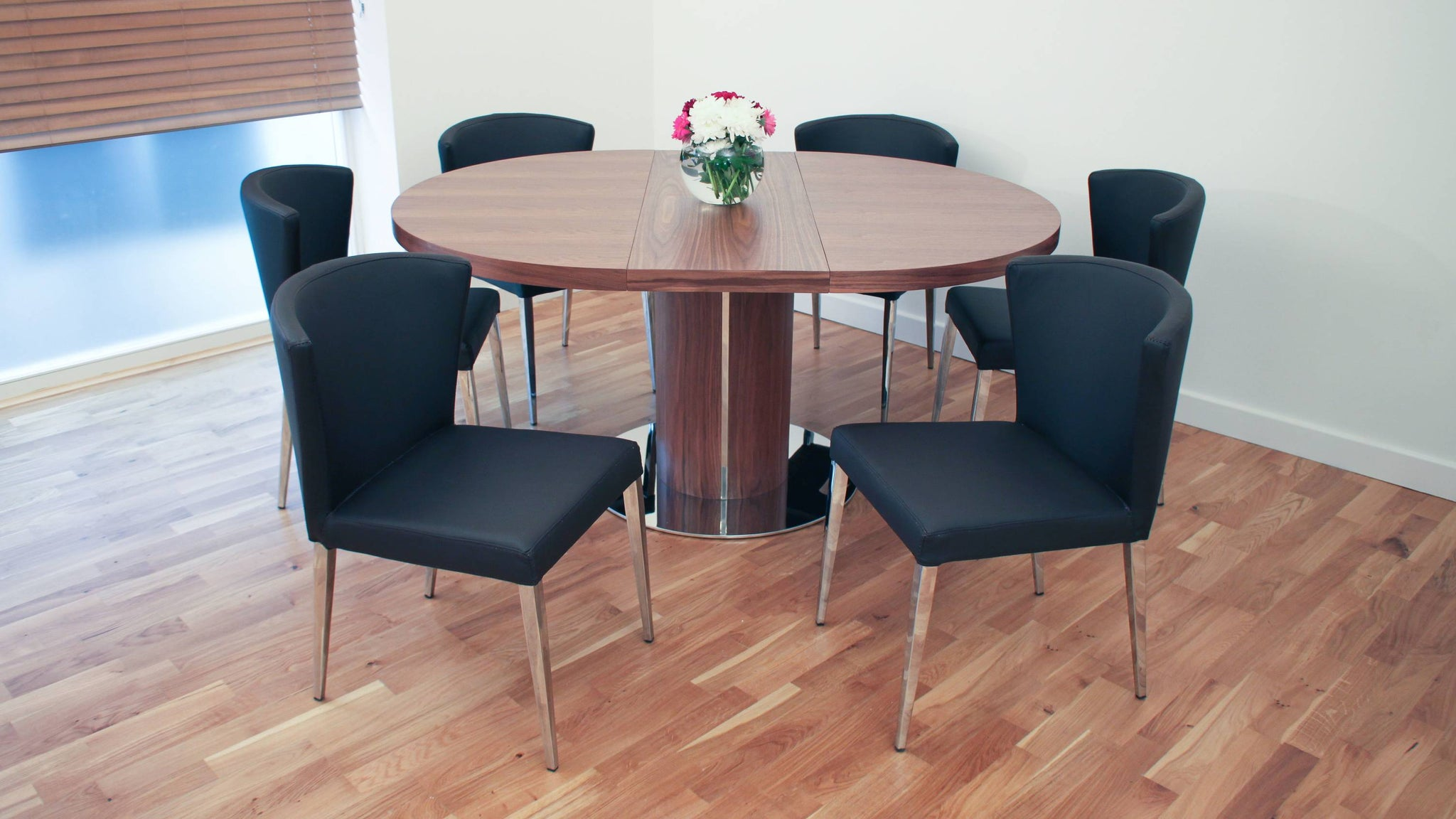 Stylish Shaped Black Dining Chairs and Easy Extending Dining Table