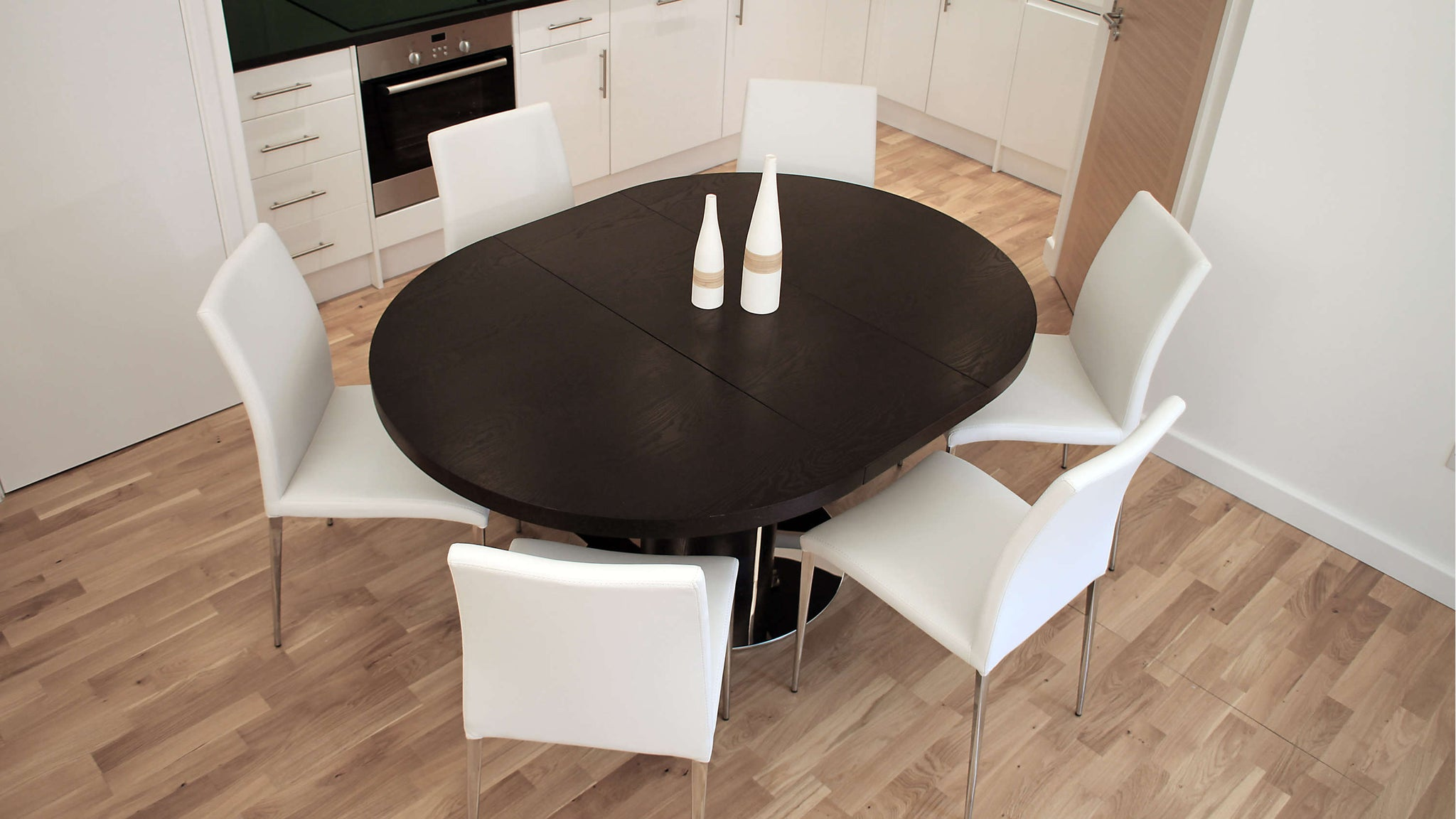 Large Oval Wenge Extending Dining Table and White Faux Leather Dining Chairs