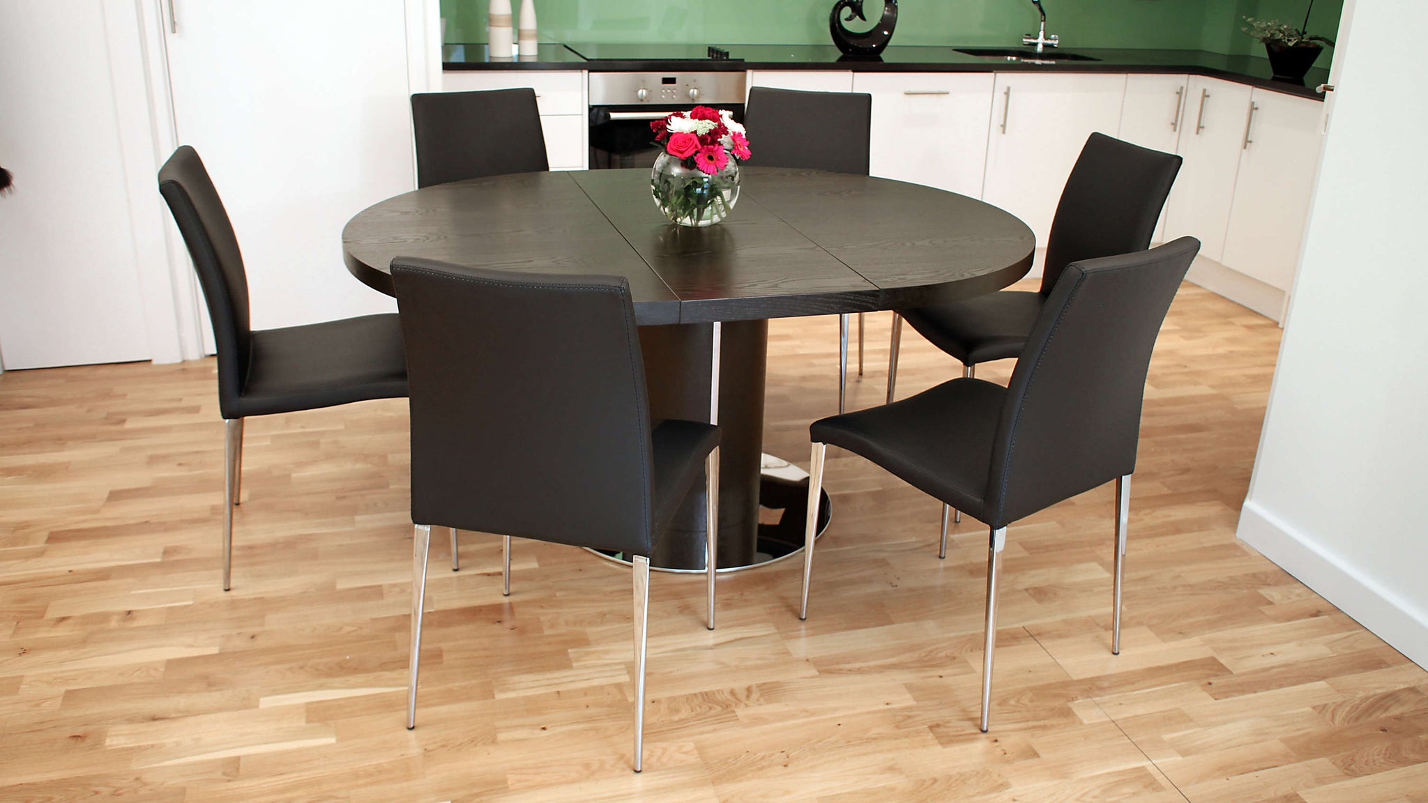 Modern Dark Wood Wenge Extending Dining Table and Black Faux Leather Dining Chairs