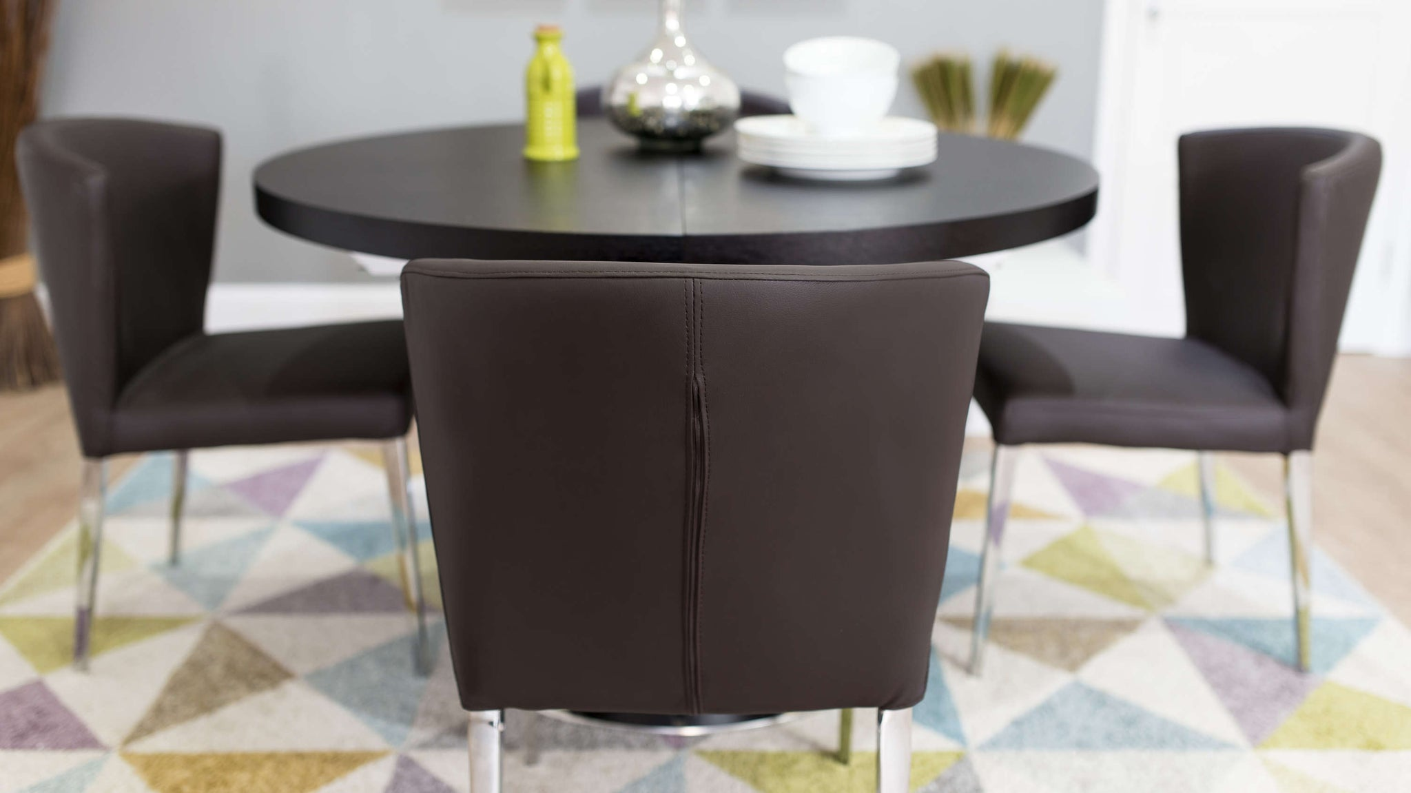 Brown Leather Dining Chairs and Dark Wood Extending Dining Table