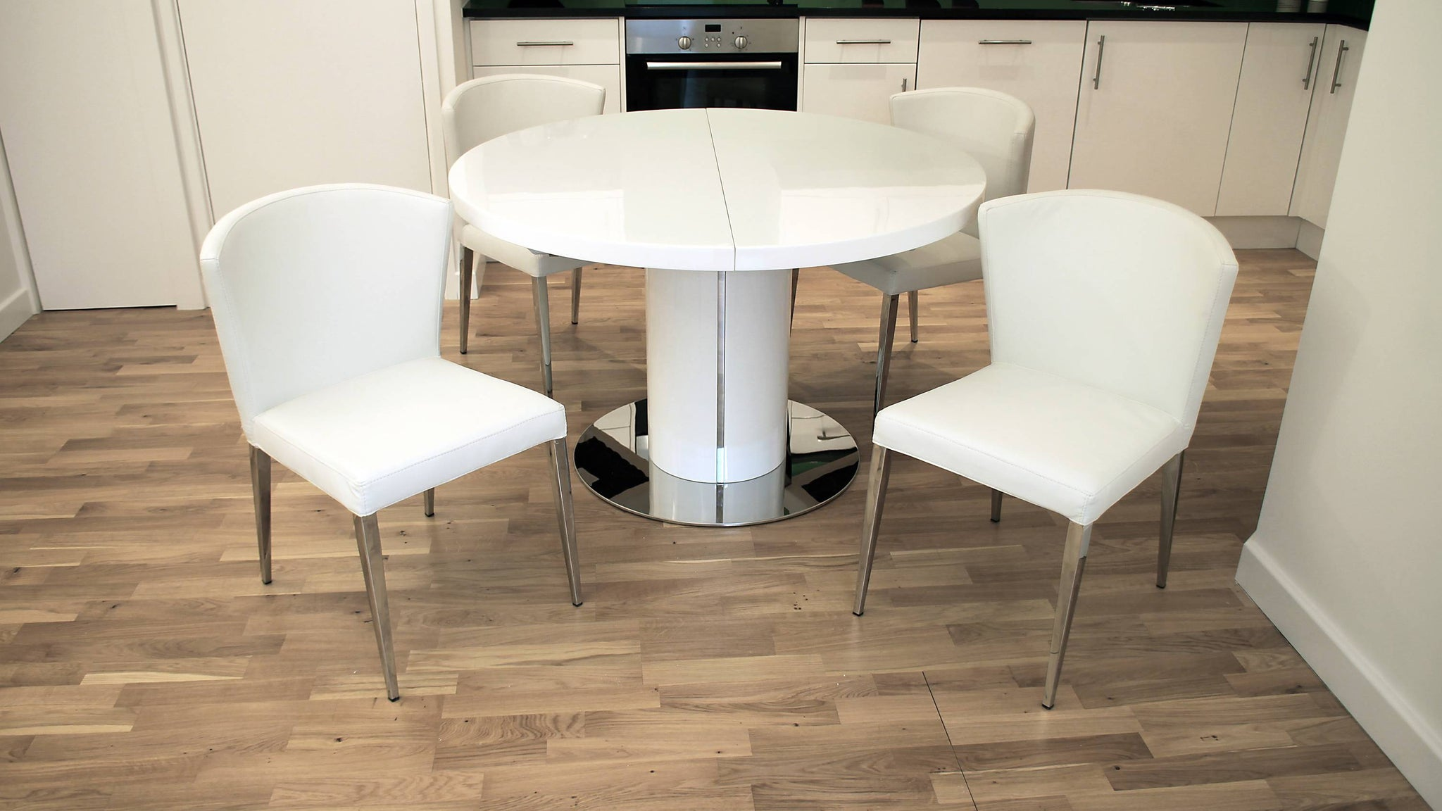 Leather Dining Chairs and Round Glossy Extending Dining Table