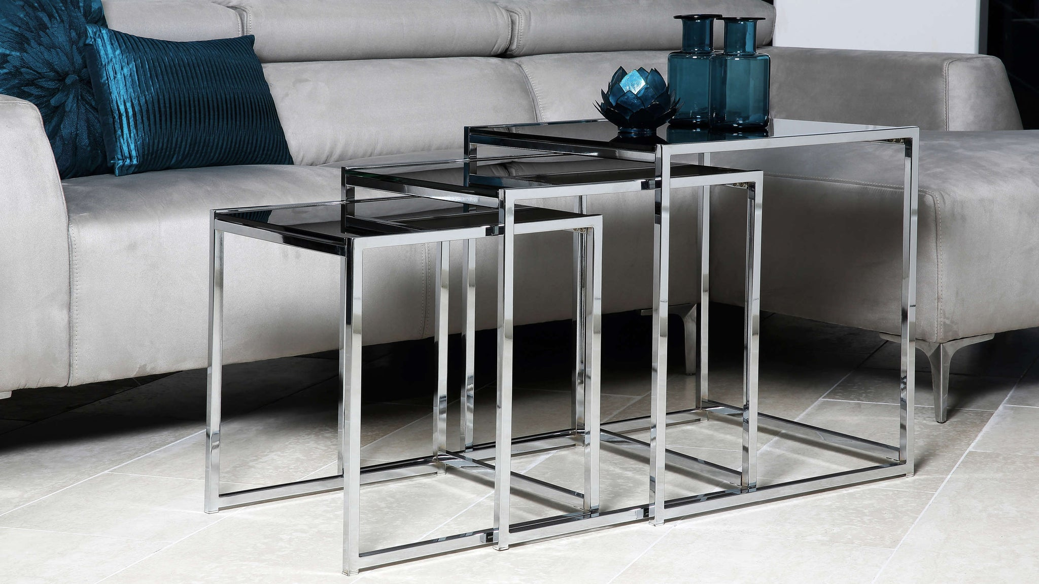 set of three black glass side tables