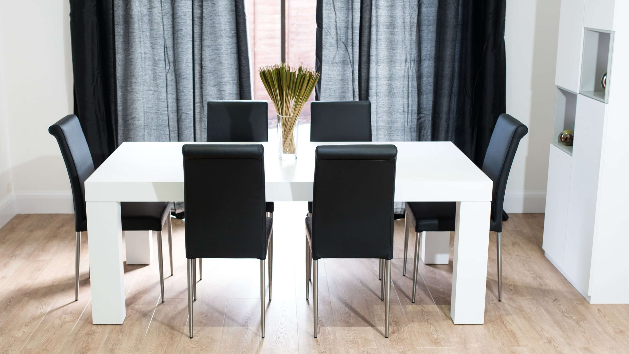 Contemporary Black Dining Chairs and Large Dining Table