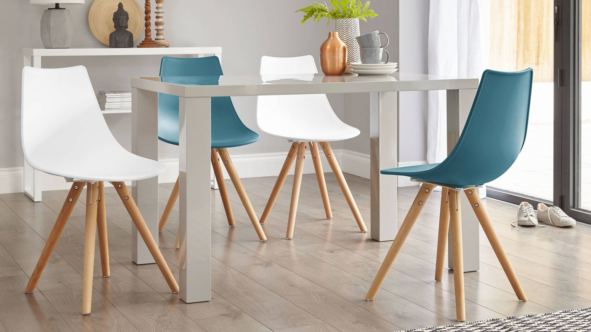 Grey gloss table with colourful chairs