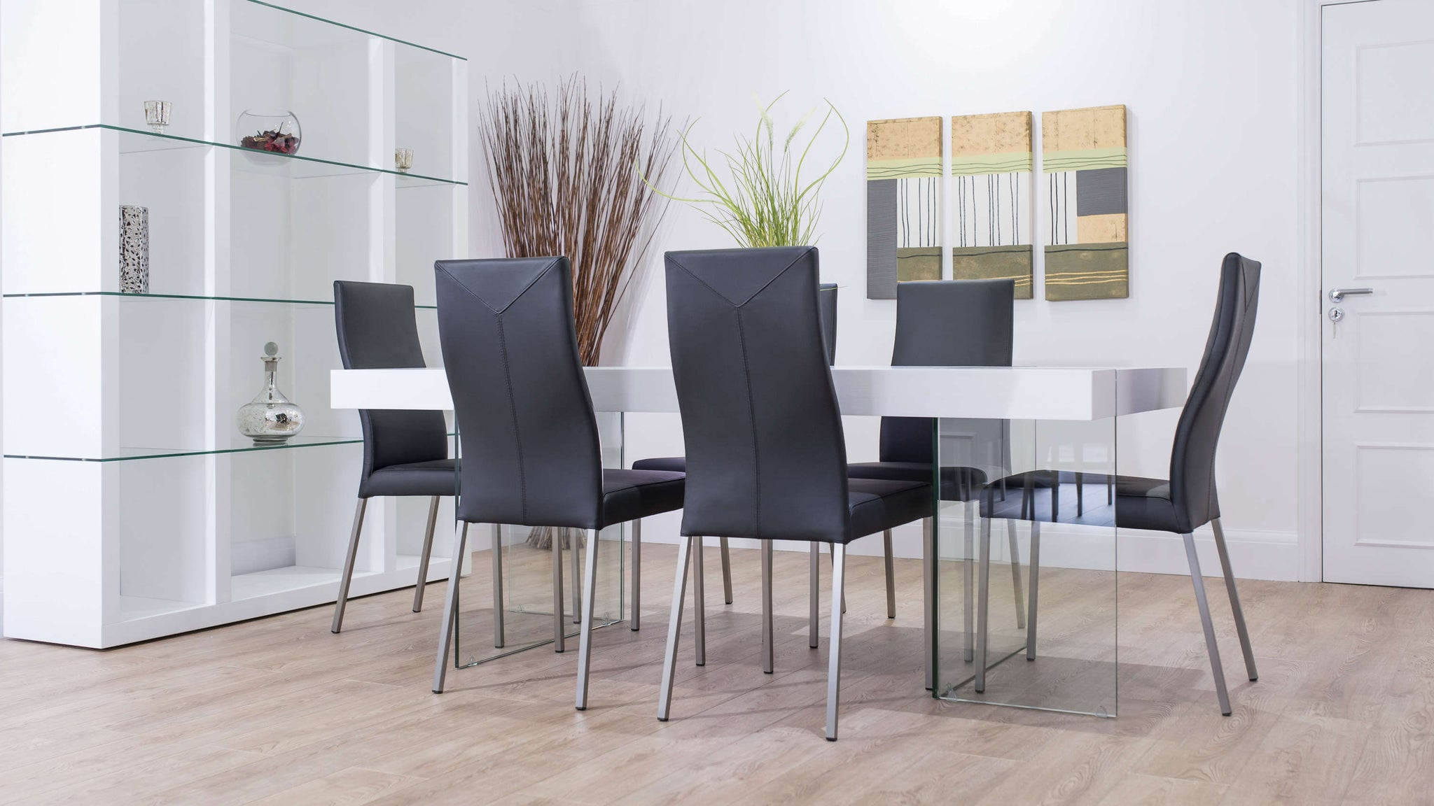 Black Leather Dining Chairs and White Glass Based Dining Table