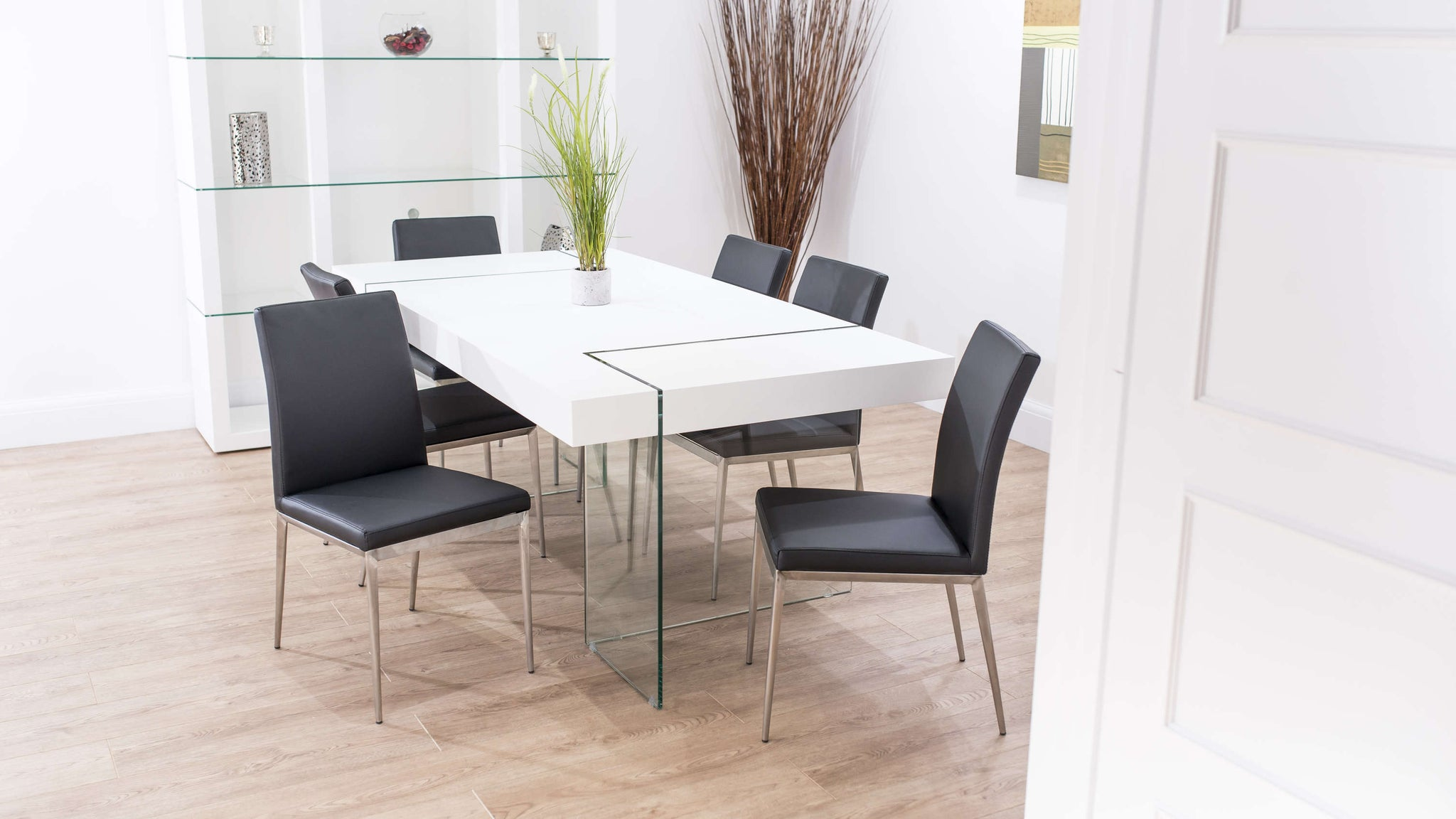 Black Dining Chairs and White Floating Dining Table