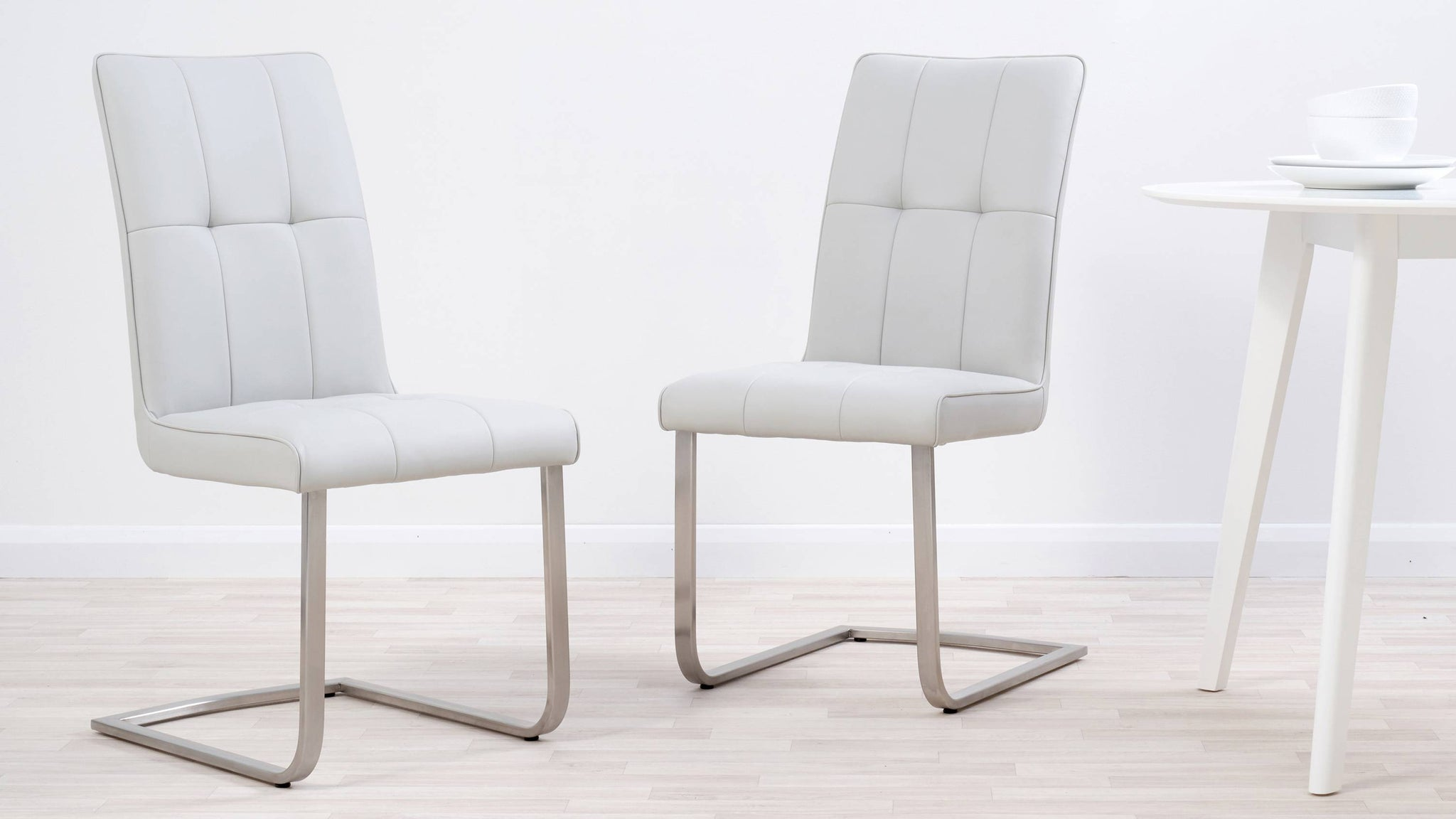 Cool grey quilted faux leather dining chairs