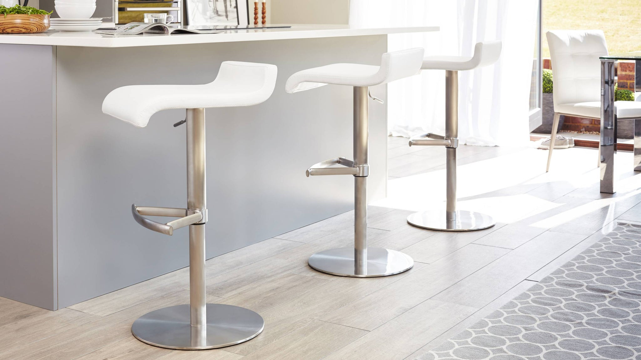 Brushed Metal Pedestal Based Bar Stool with Foot Rest