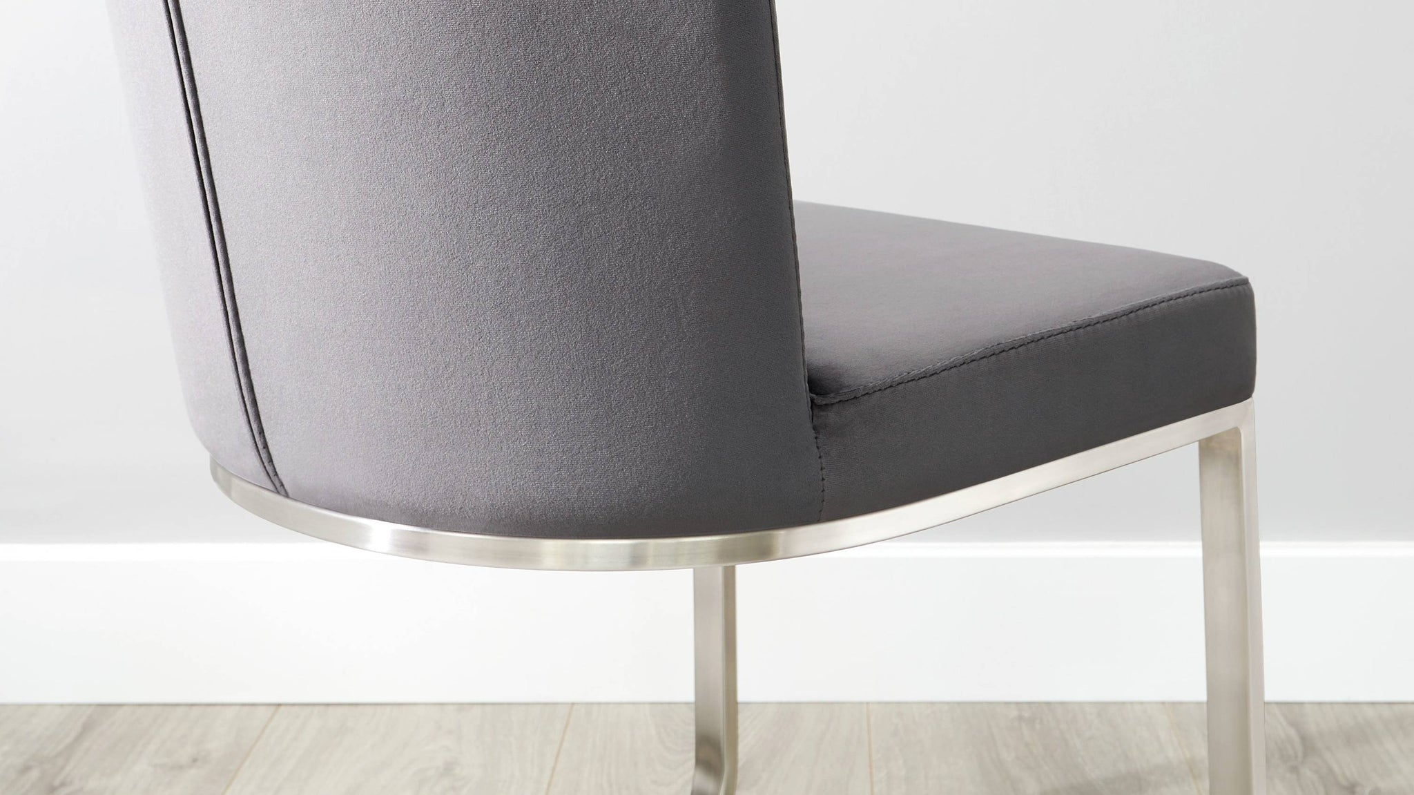 Velvet and brushed steel dining chair