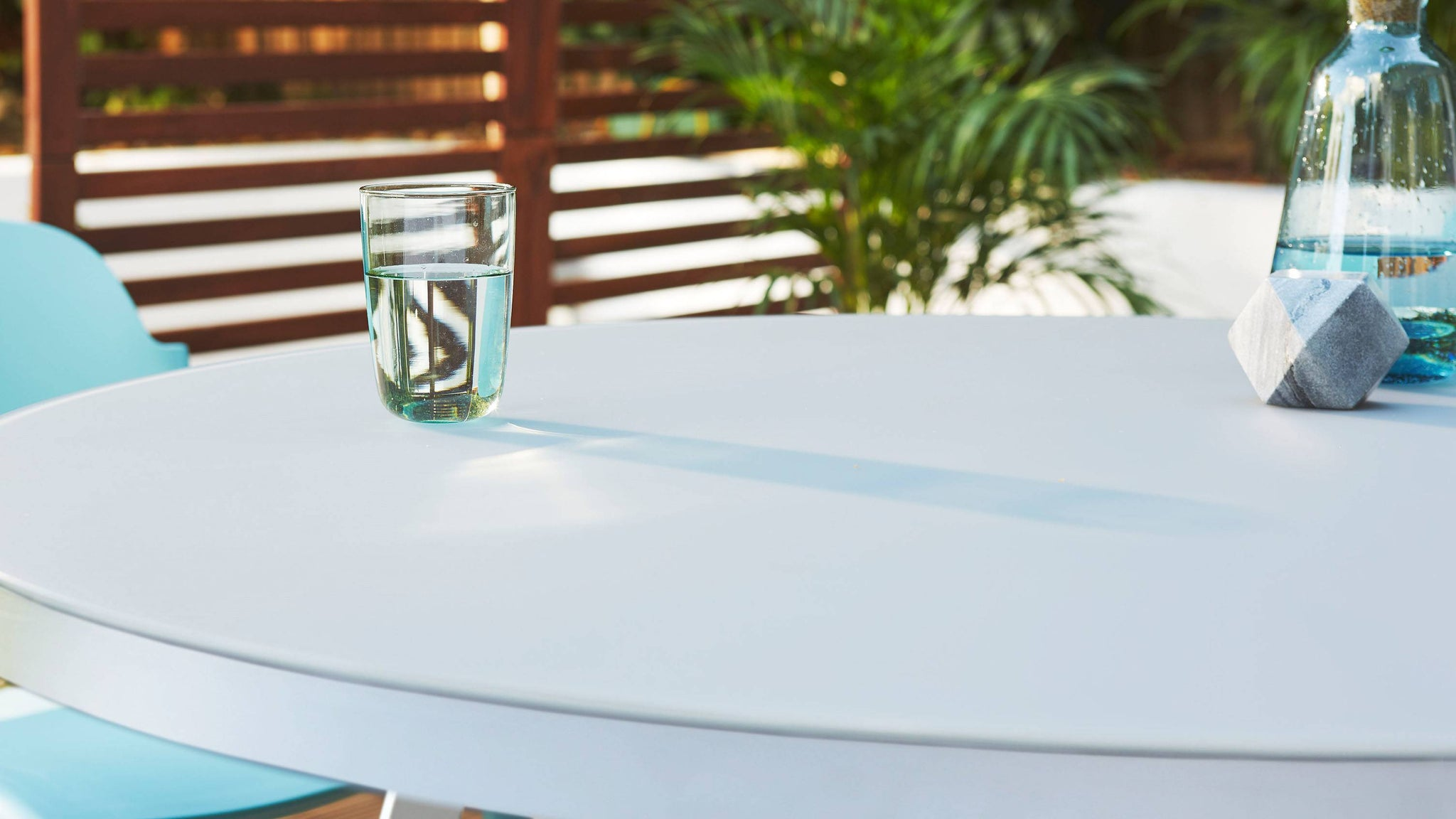 etched glass table and plastic chair
