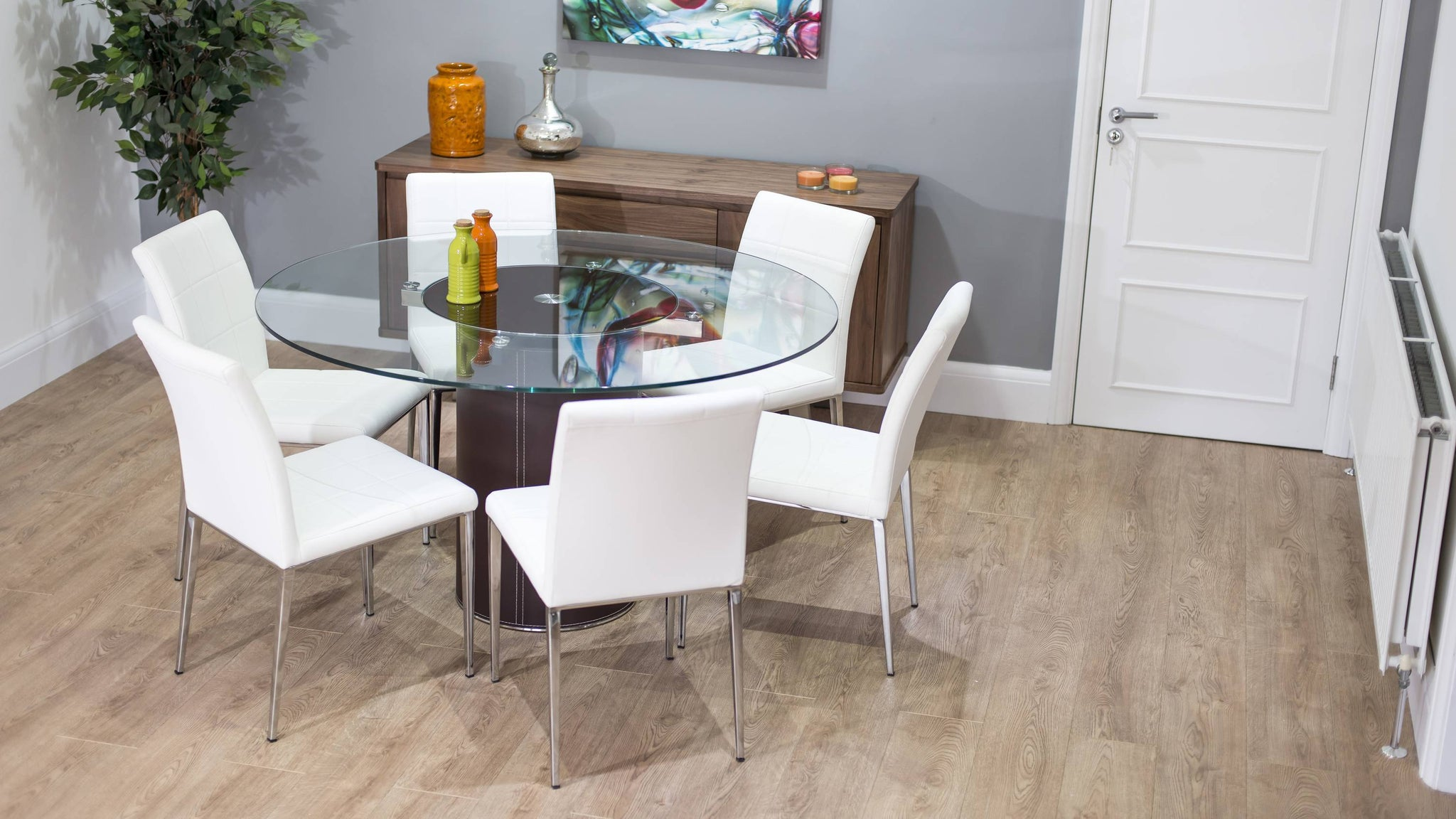 White Chairs and Glass Dining Table