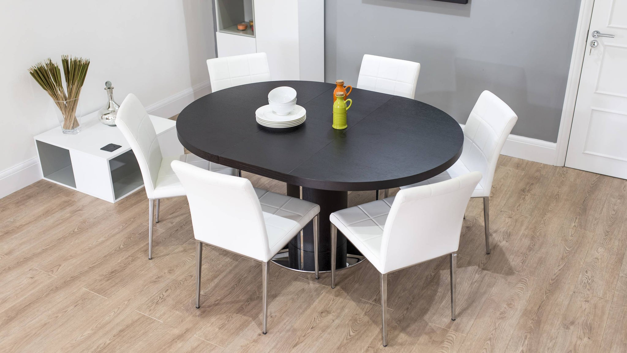 Oval Dark Wood Extending Dining Table and White Chairs