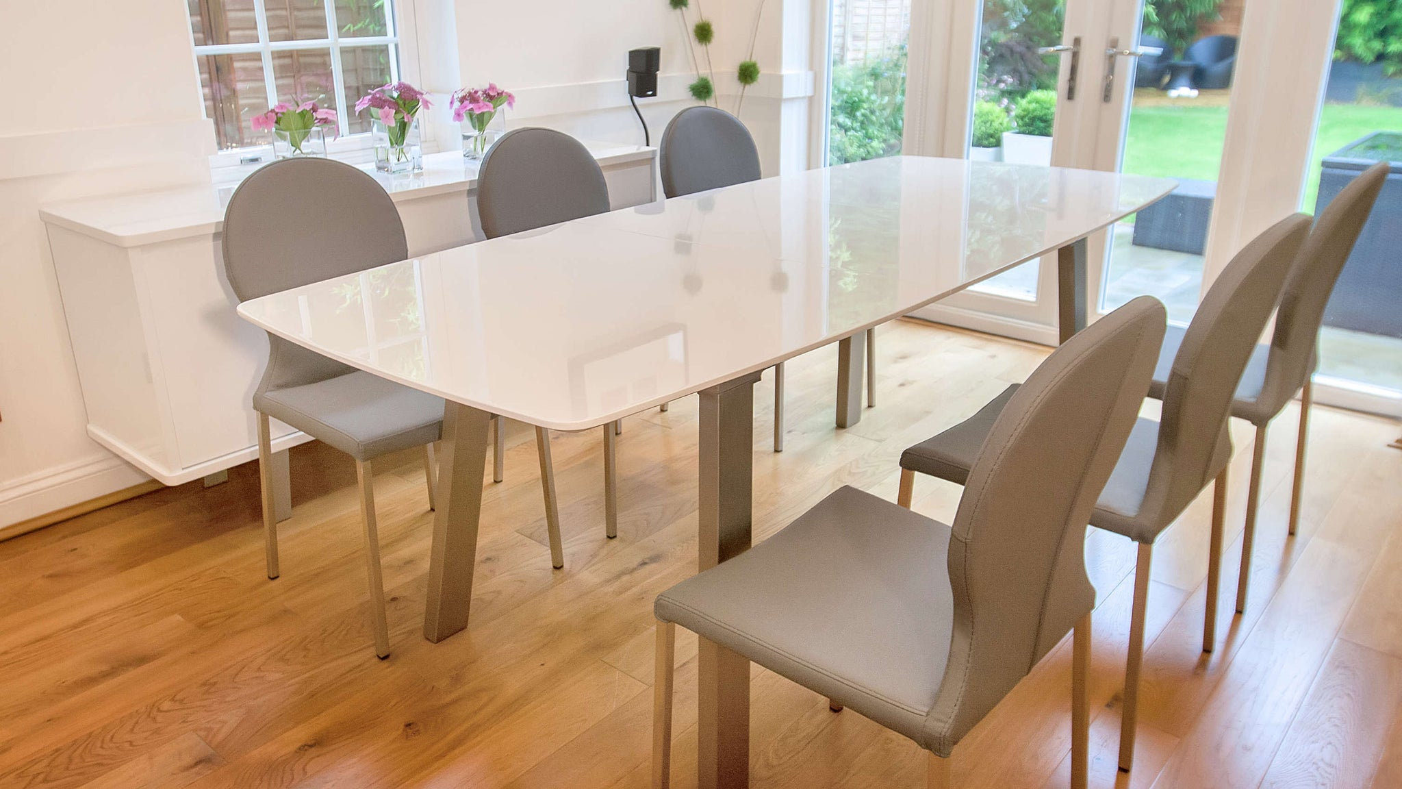 White Gloss Extending Dining Table and Grey Chairs