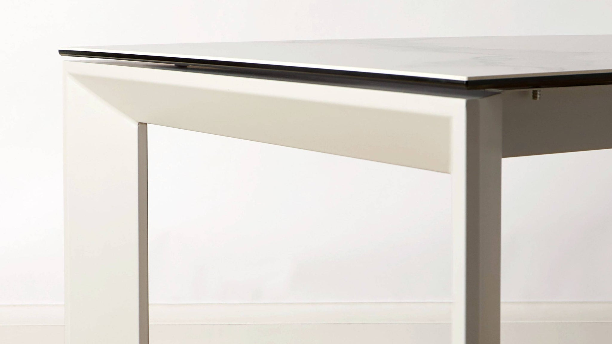 Chamfered edge extending dining table