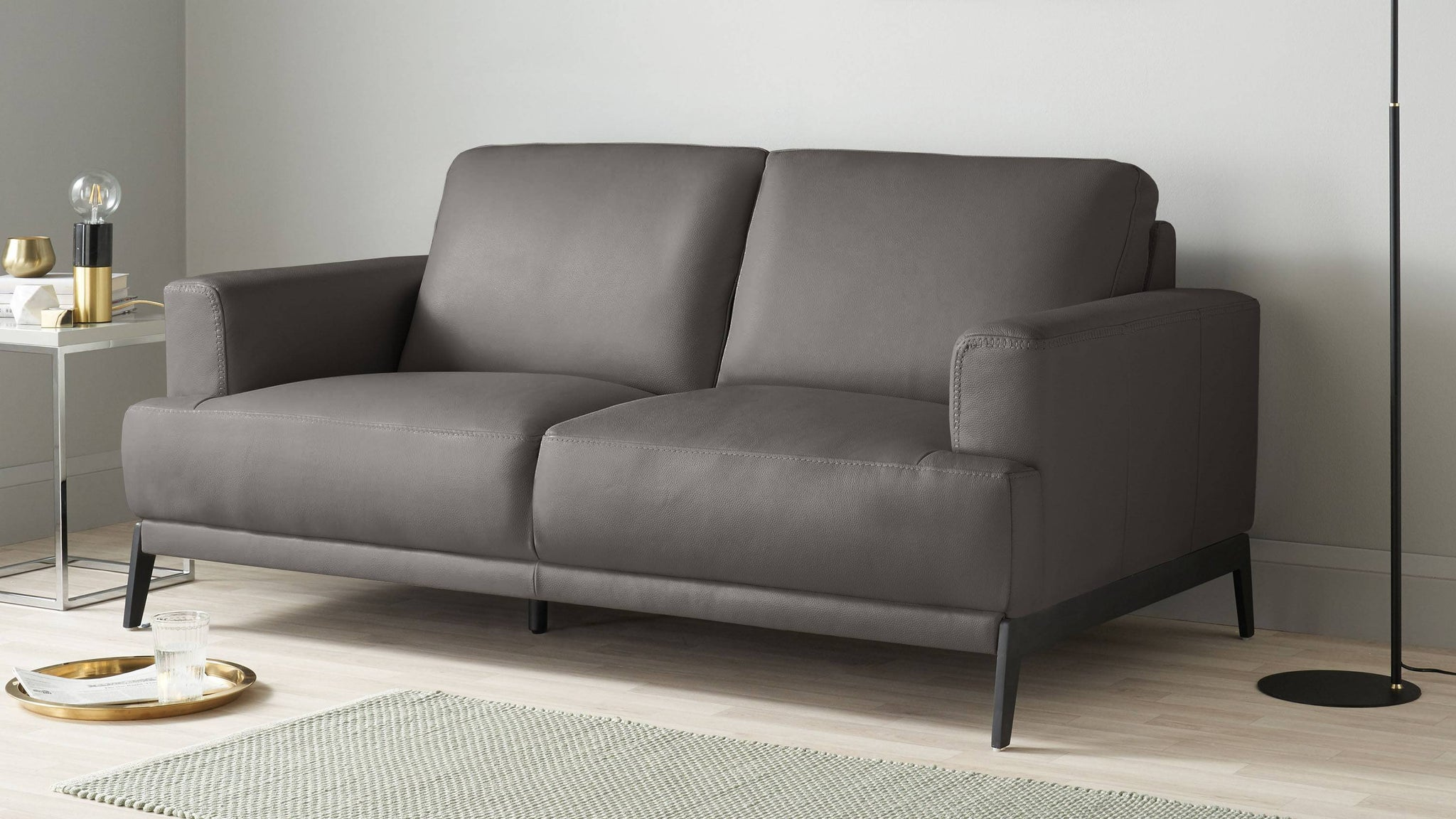 Dark warm grey leather sofa