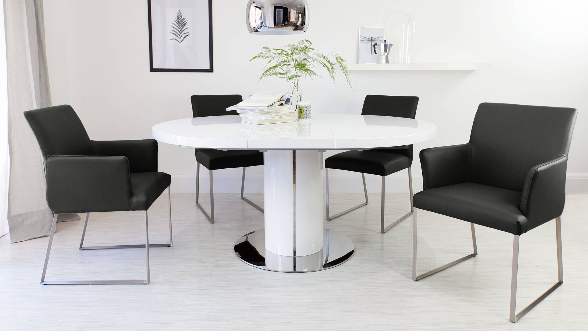 Black Leather Dining Chairs and White Gloss Extending Dining Table