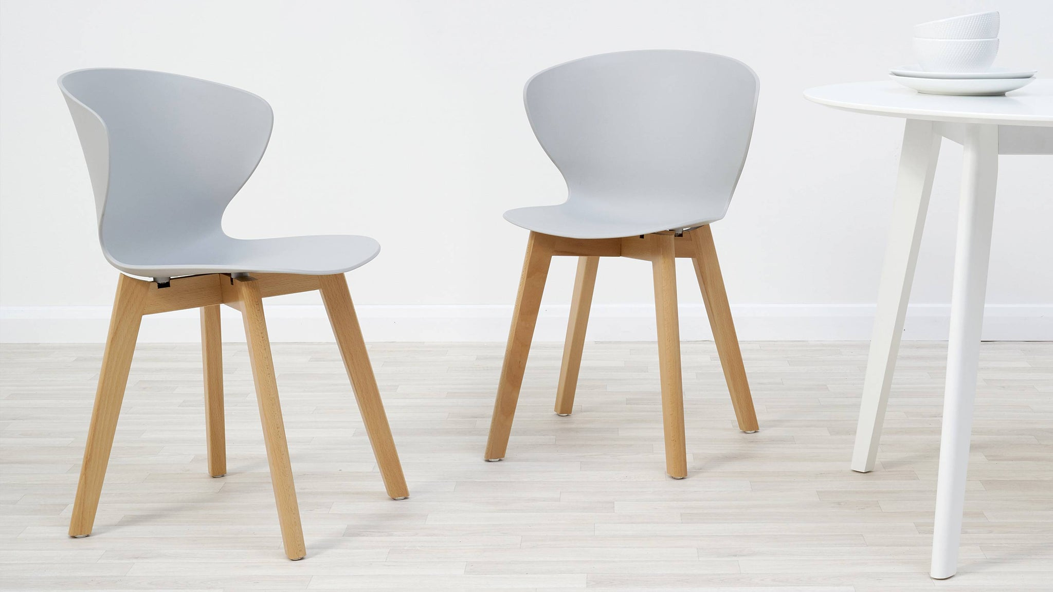 Cool grey plastic and wooden dining chair