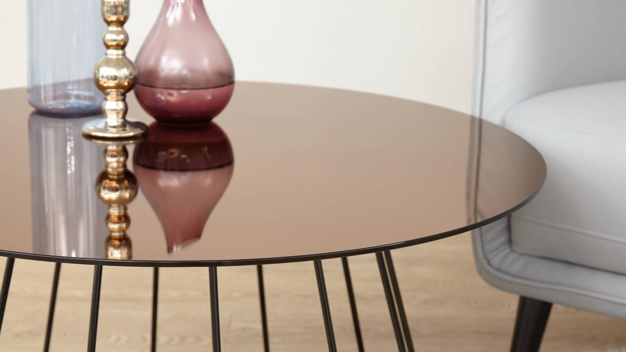 Round bronze and black coffee table