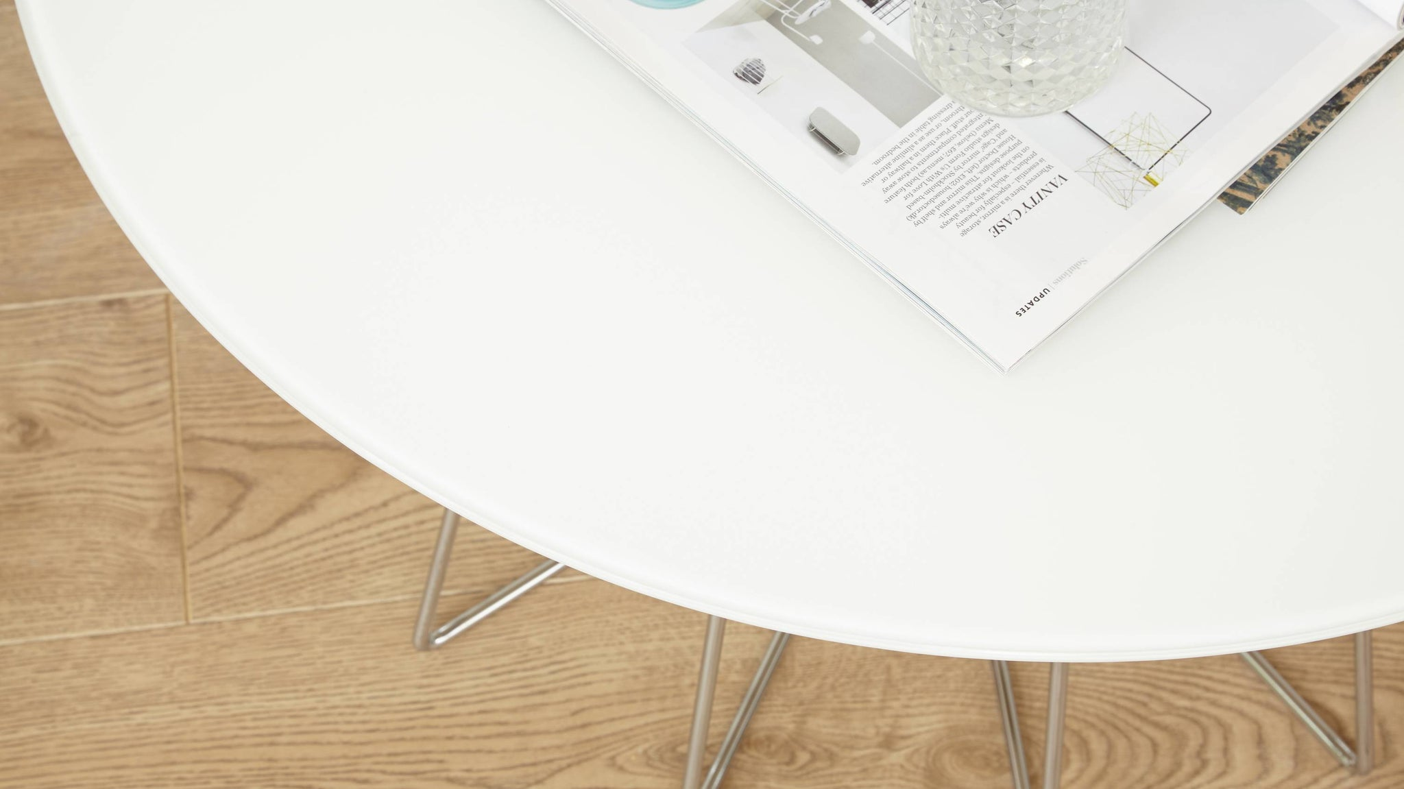 White glass and chrome round coffee table