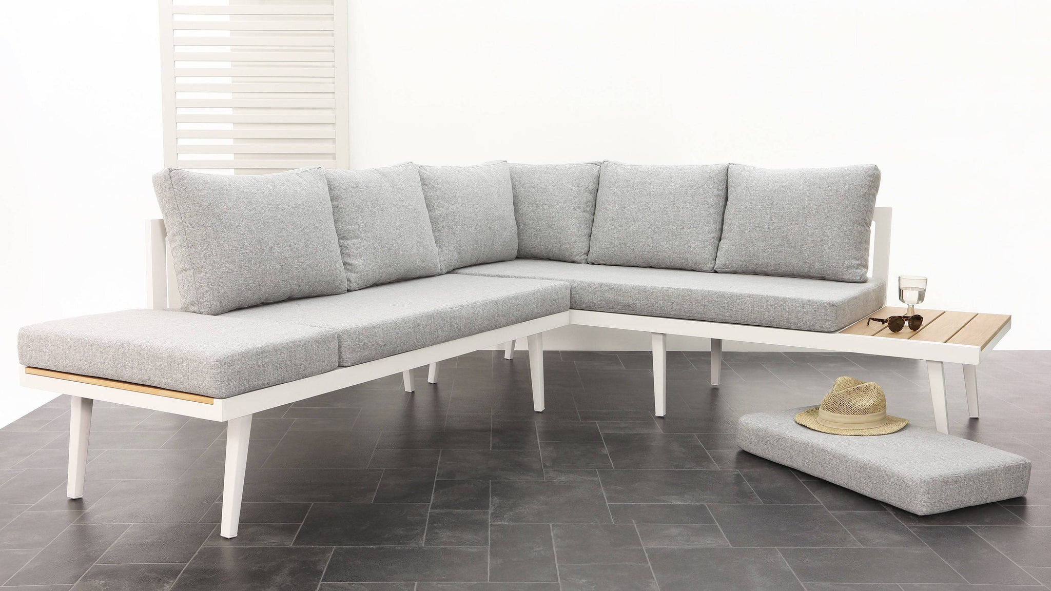 Large outdoor light grey corner bench