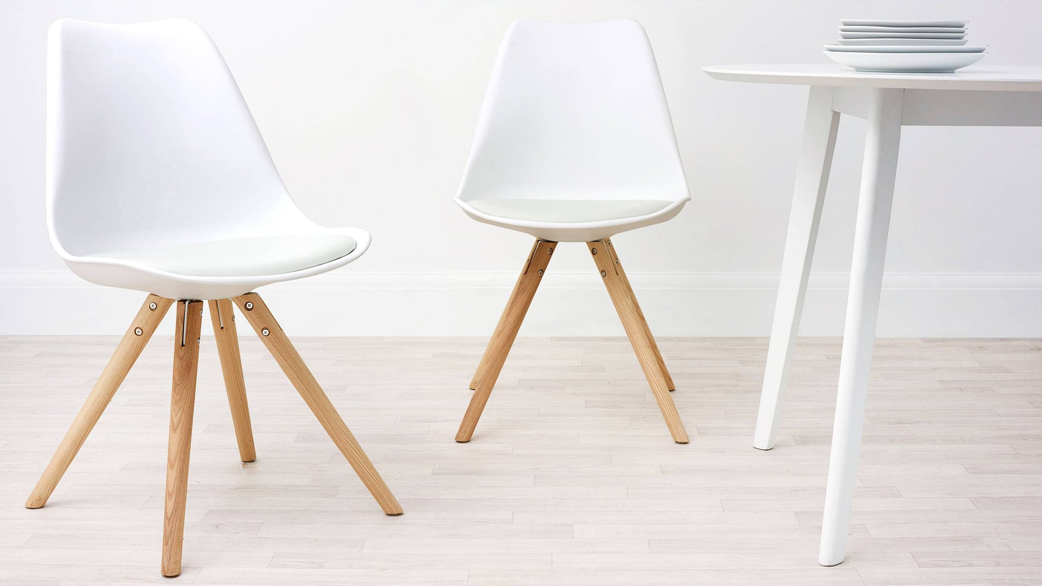 white plastic plastic dining chairs with cushion