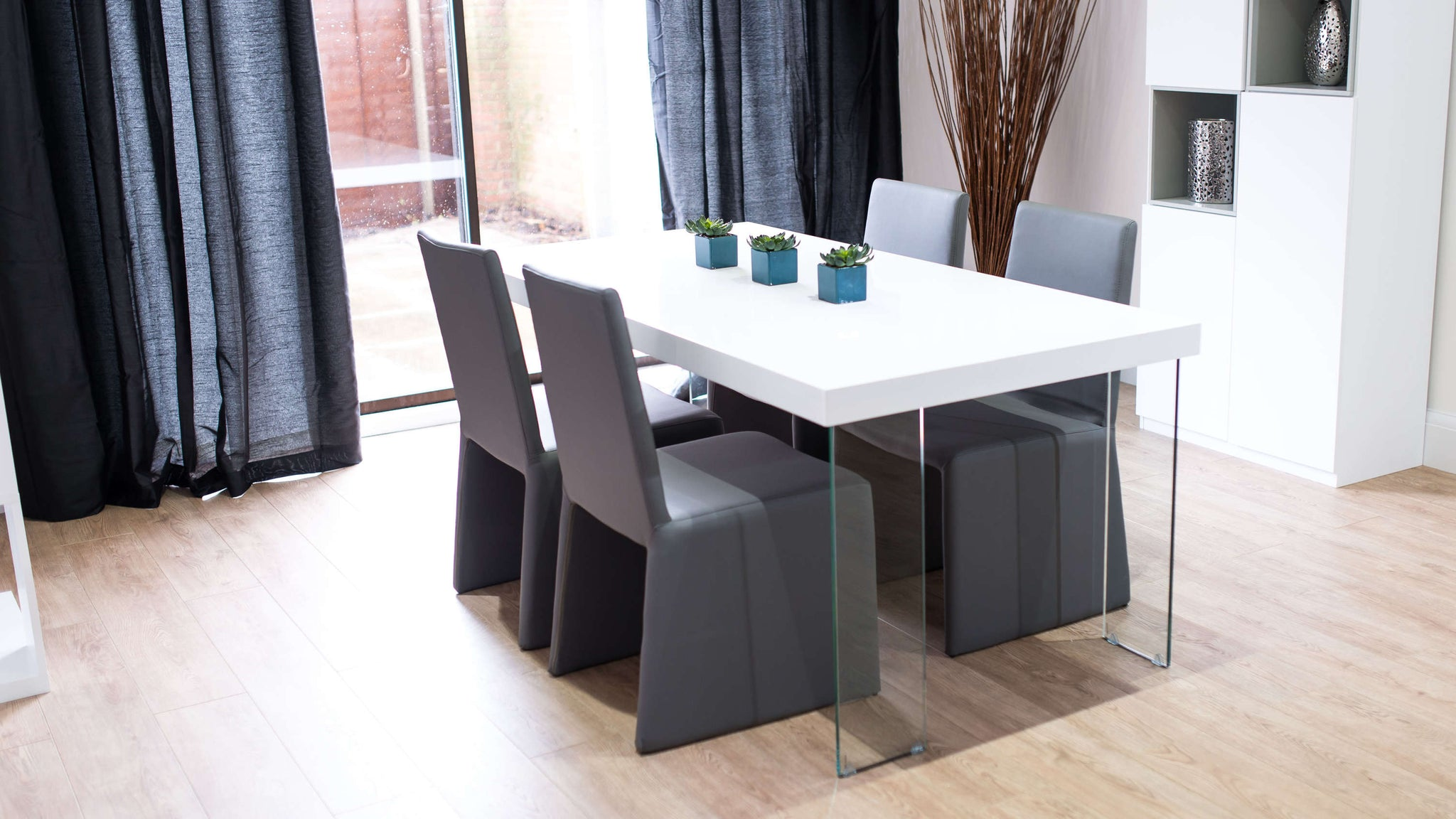 Stylish White Gloss Floating Dining Table and Grey Chairs