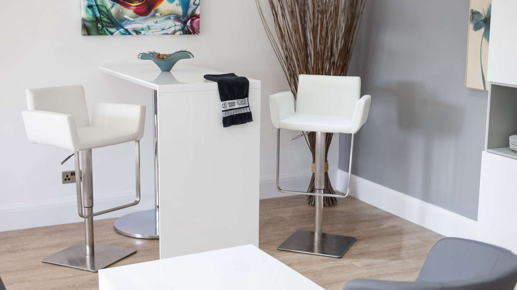 Modern White Bar Stools with a Brushed Metal Base