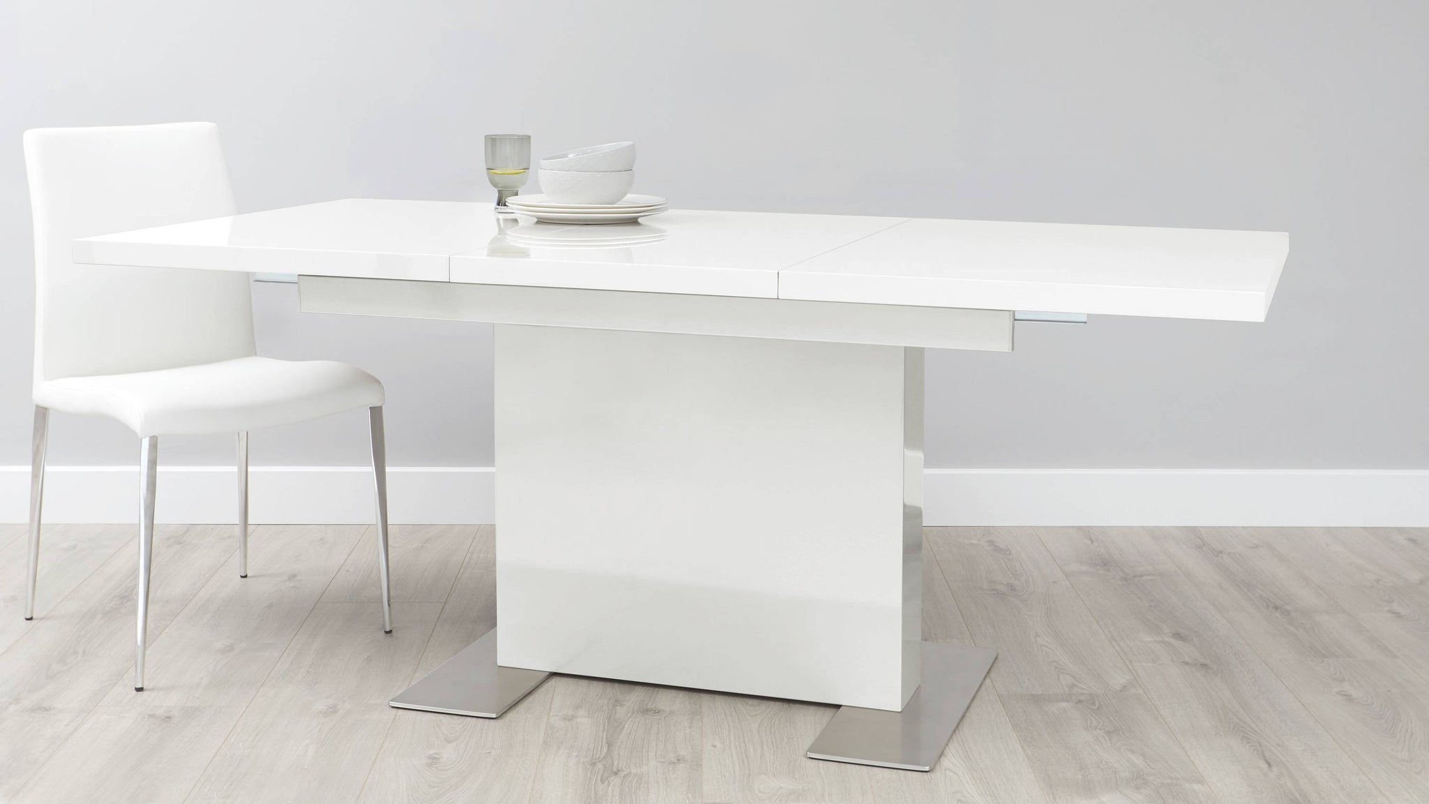 White gloss and chrome extending dining table
