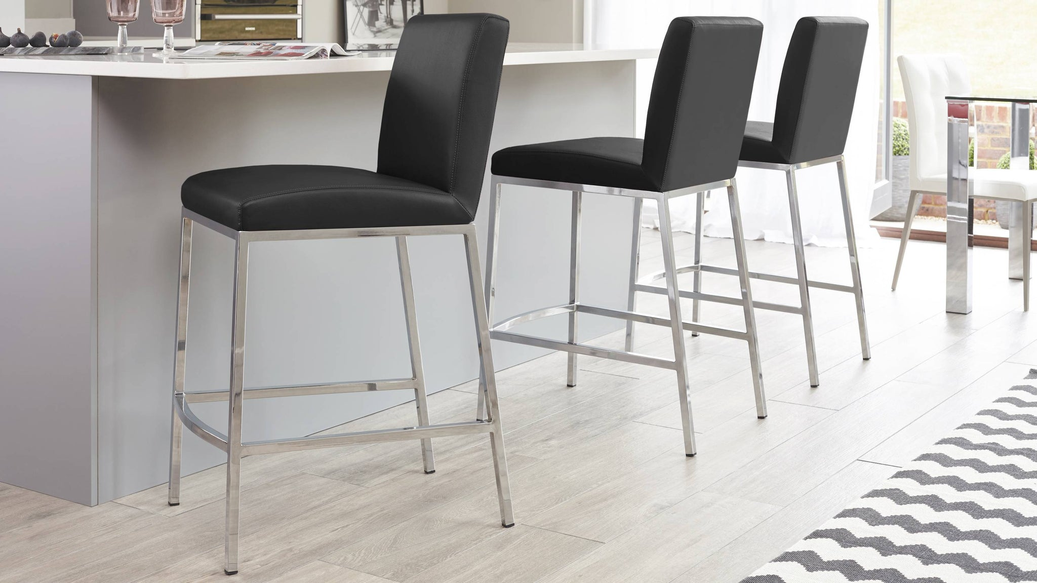 Black and Chrome Bar Stool with a Footrest