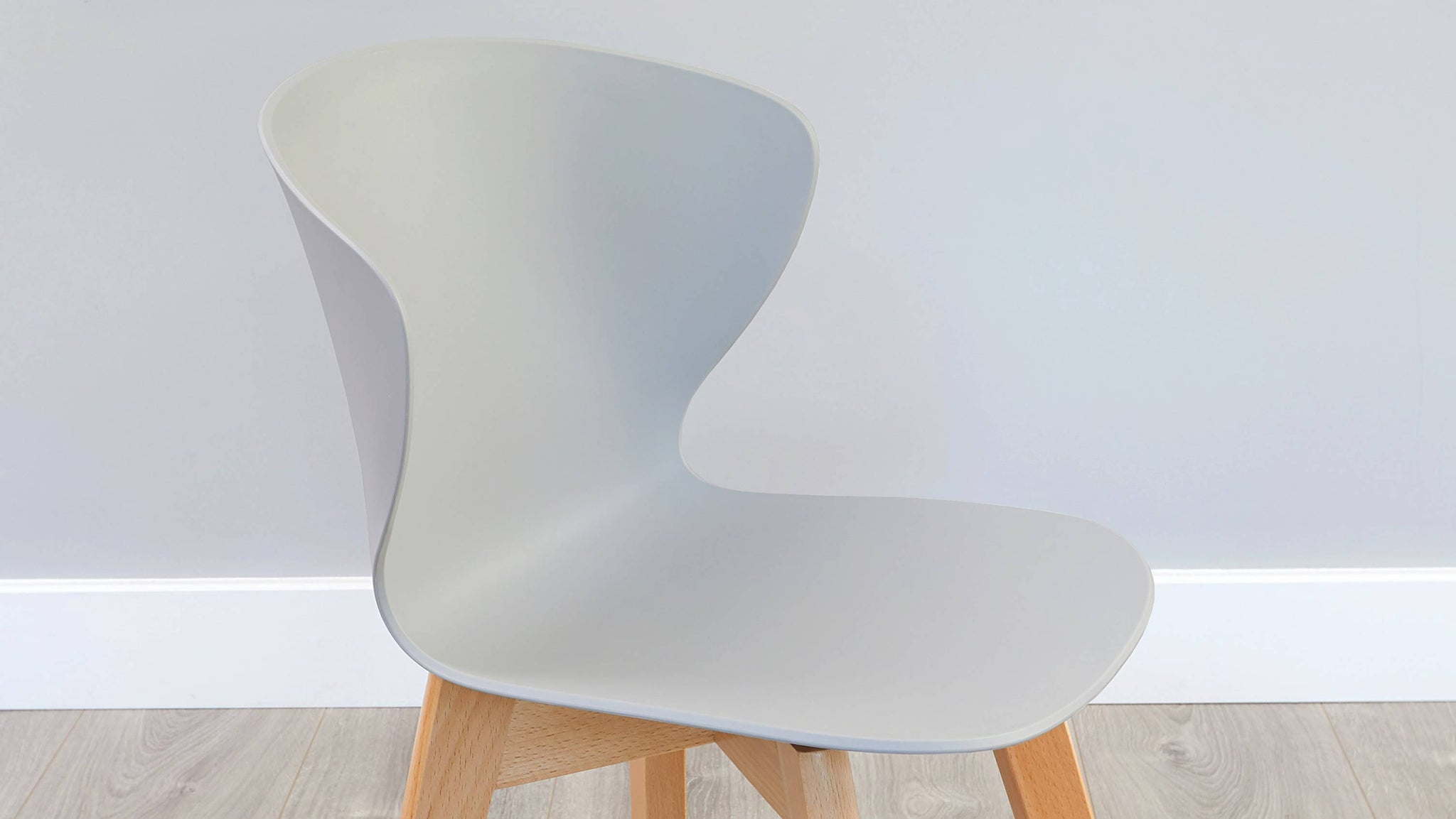 Comfortable plastic and wooden dining chairs