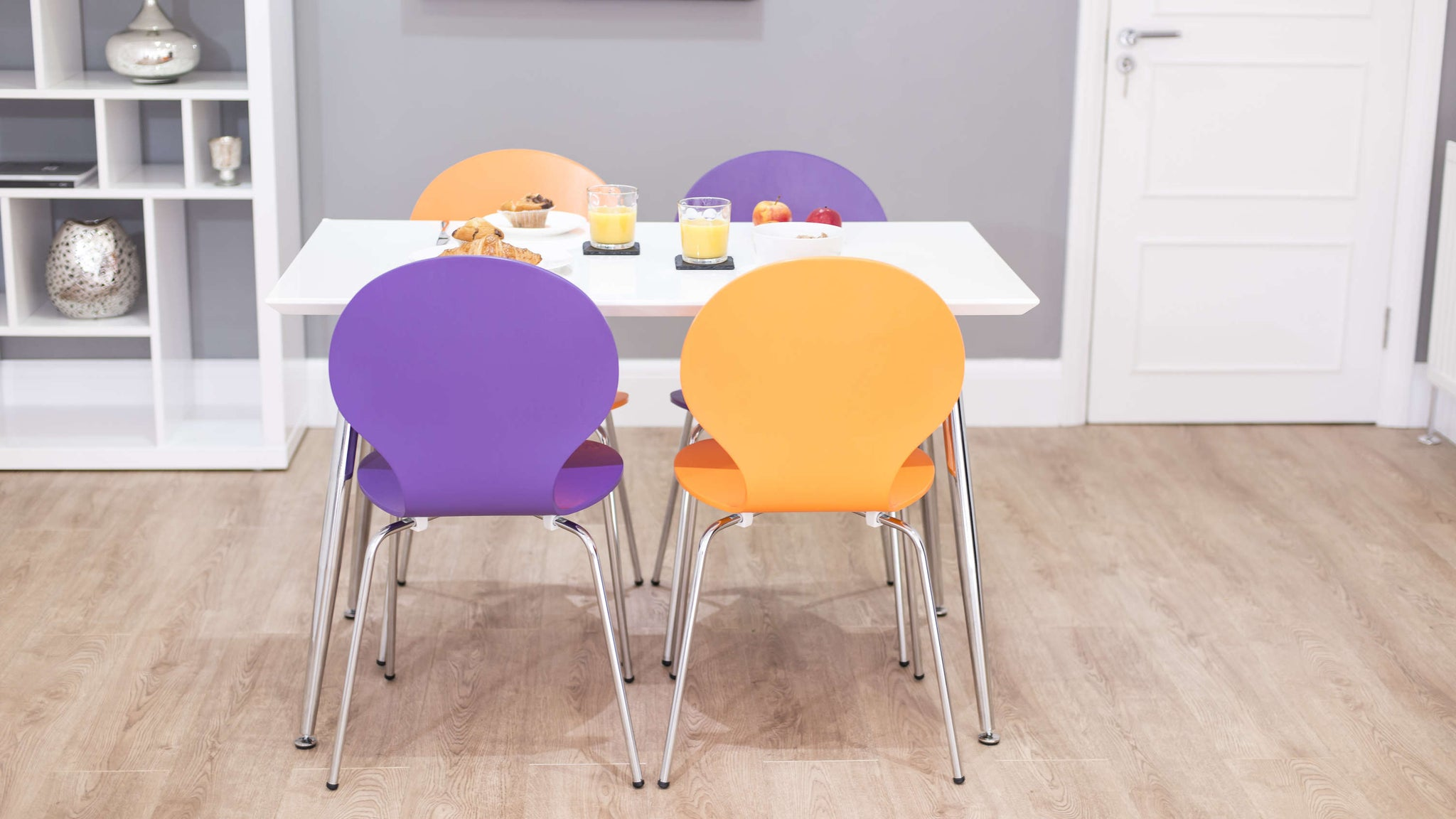 Small White Dining Table and Stackable Dining Chairs