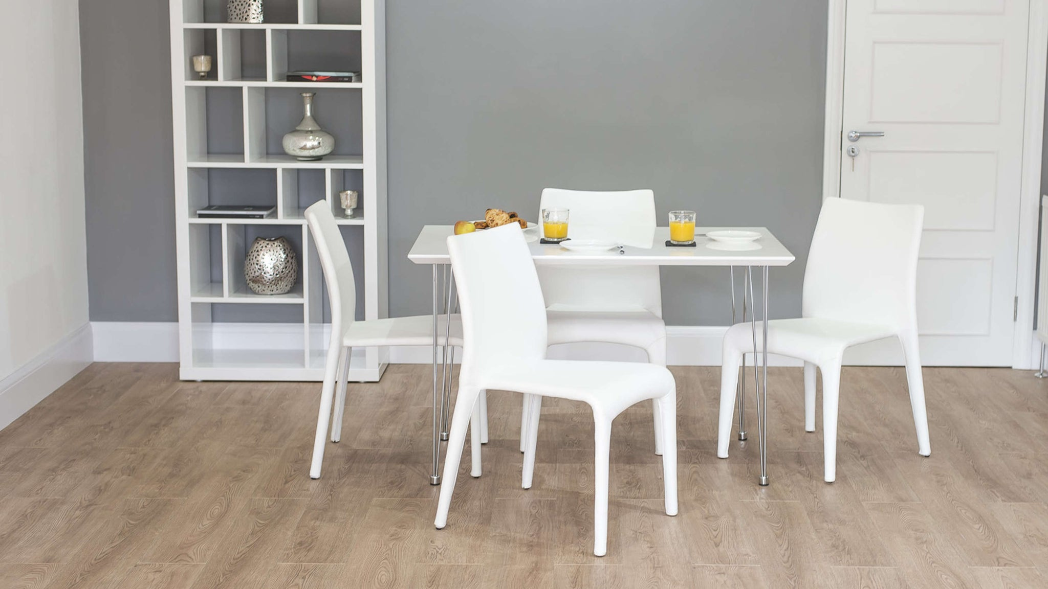 Comfortable Dining Chairs and Glossy Dining Table