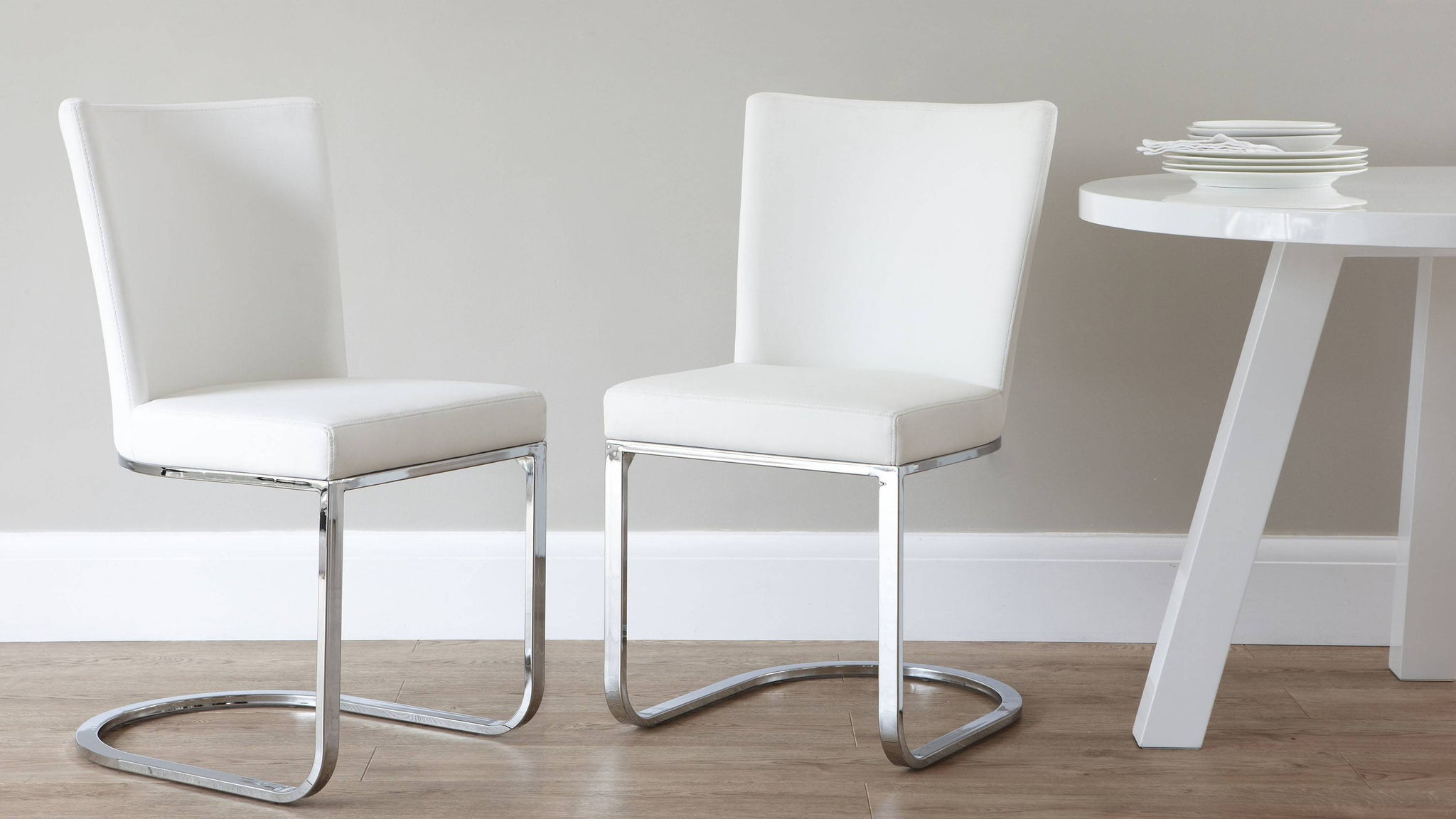 White modern dining chair with chrome leg