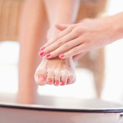 Paraffin wax treatment on the feet for soft, hydrated skin