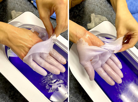 Peeling paraffin wax off hands for soft skin.