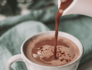 pouring hot original cocoa powder