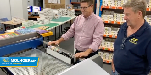 Rob Molhoek MP assembles his first Australian made jigsaw puzzle at QPuzzles Ashmore