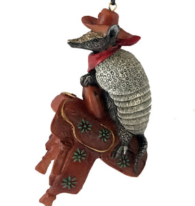 Western Cowboy Christmas ornament -Armadillo with cowboy hat and bandana sitting  on saddle