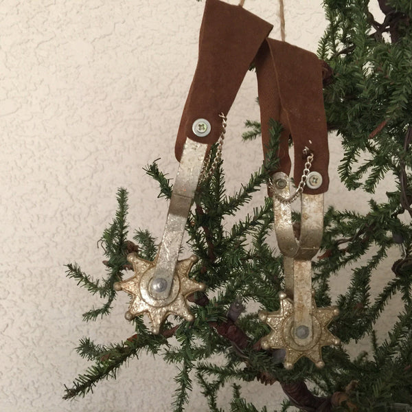 Spurs Cowboy Christmas ornament hanging from tree - North Pole West