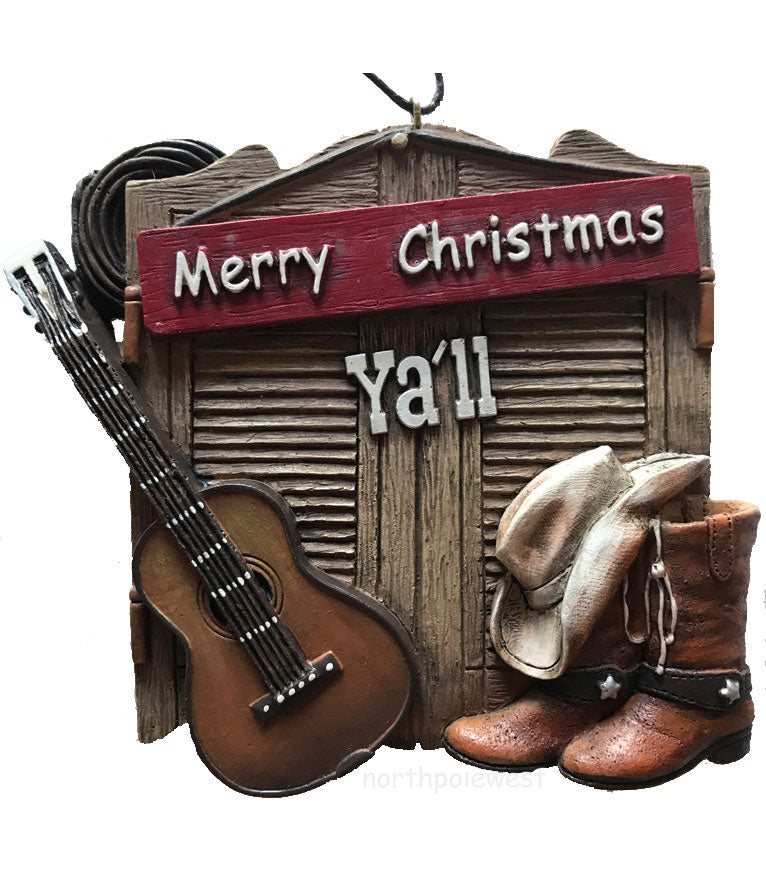 rustic cowboy Christmas barn door ornament with guitar,rope,cowboy boots and hat with a sign that says Merry Christmas Y'all