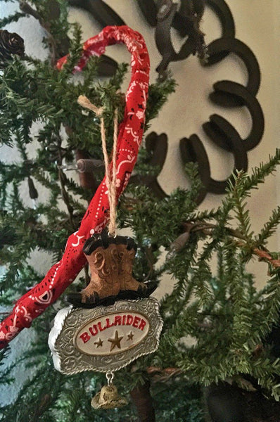 cowboy Christmas bull rider ornament by tree and horseshoe wreath