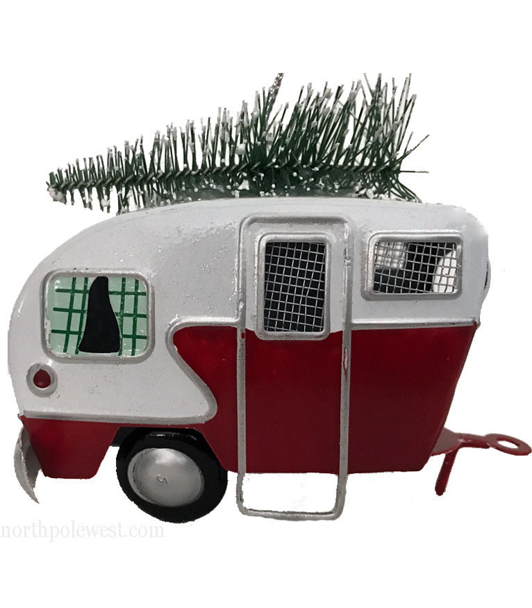 Tin camper trailer with Christmas tree on top Christmas ornament from North Pole West