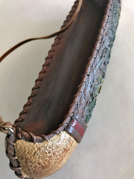 top detail of Rustic old west mini canoe Christmas ornament from North Pole West Cowboy Christmas Store