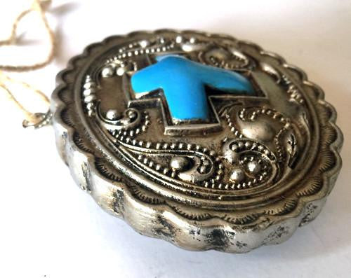 southwestern style Christmas ornament looks like concho cowboy belt buckle-from North Pole West