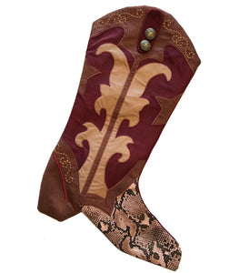 Warm red cowboy boot Christmas stocking with snakeskin pattern for country western holiday decor from North Pole West