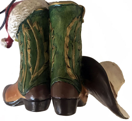 Reverse side of green cowboy boots with white cowboy hat & Santa Claus hat cowboy Christmas ornament from North Pole West