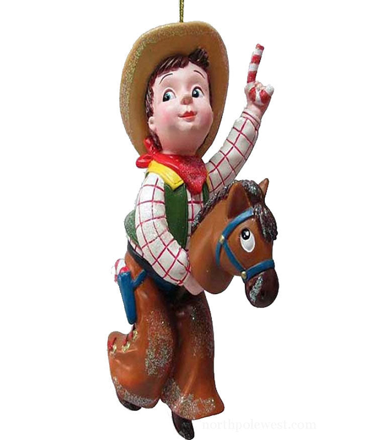 Cute vintage style cowboy child with stick pony and candy cane from North Pole West
