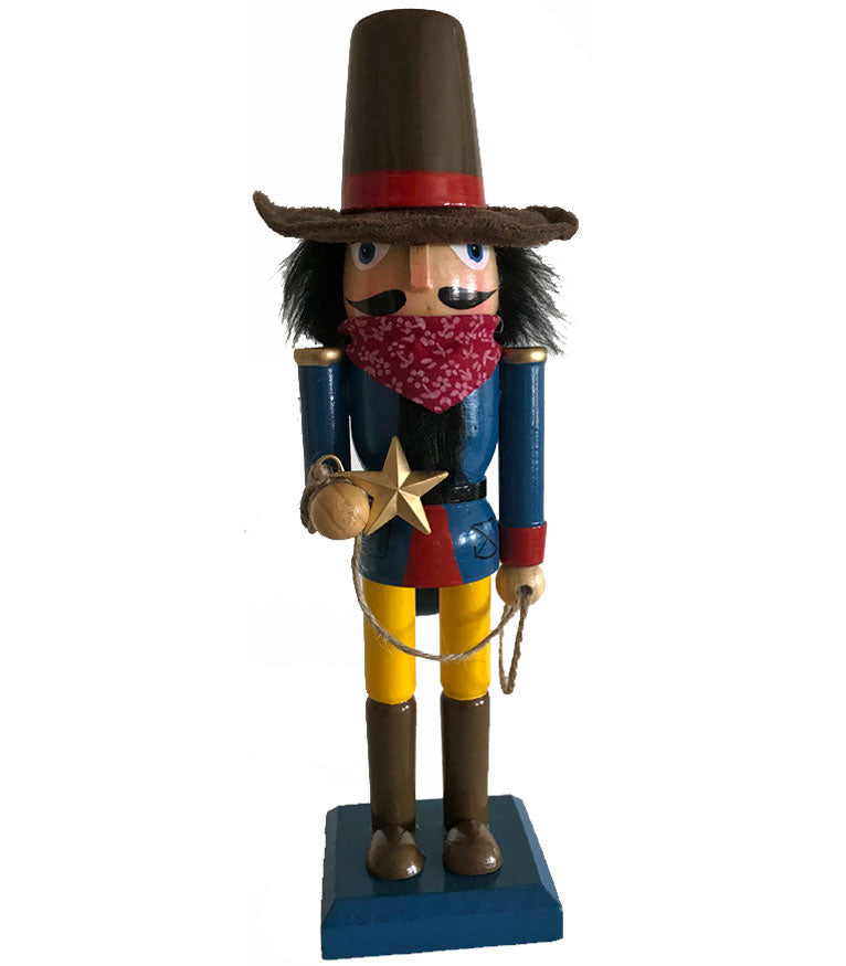 cowboy nutcracker with star lasso and cowboy hat and red bandana from North Pole West