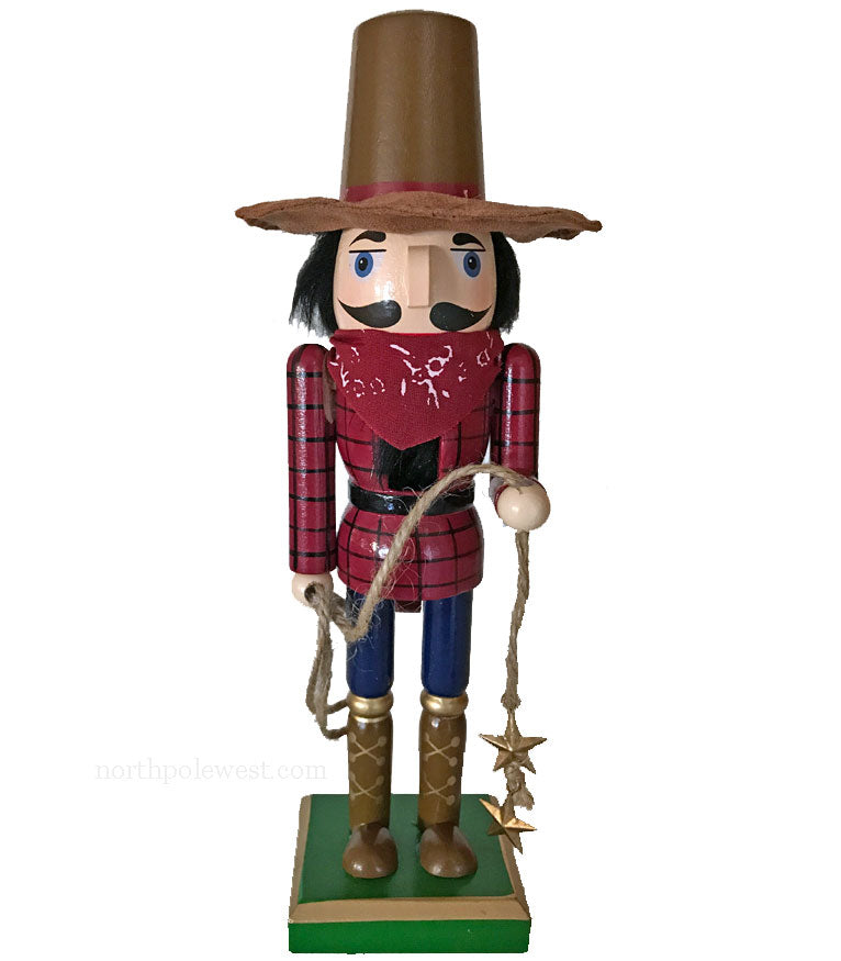 Cowboy Christmas nutcracker with red shirt and lasso from North Pole West
